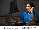 young handsome doctor working...   Shutterstock . vector #1204005139
