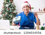 doctor with gift box in the...   Shutterstock . vector #1204014556