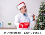 doctor with gift box in the...   Shutterstock . vector #1204014586