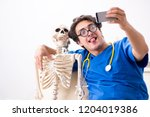 funny doctor with skeleton in...   Shutterstock . vector #1204019386
