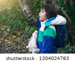 portrait side view of boy... | Shutterstock . vector #1204024783