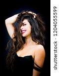 beautiful woman on black... | Shutterstock . vector #1204055599