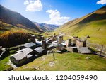 ushguli village with typical... | Shutterstock . vector #1204059490