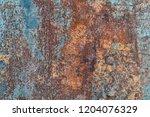 abstract rusty metal texture ... | Shutterstock . vector #1204076329