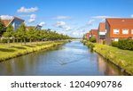 natural canal in modern suburb... | Shutterstock . vector #1204090786
