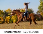 Stock photo beautiful girl riding a horse in countryside 120410908