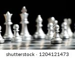 silver pawn is on the first... | Shutterstock . vector #1204121473