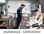 marine engineer officer in... | Shutterstock . vector #1204131010