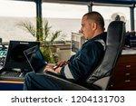 marine navigational officer or... | Shutterstock . vector #1204131703