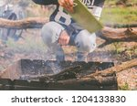 a tourist makes a fire in the... | Shutterstock . vector #1204133830