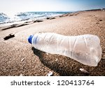 empty bottle at a beach in italy - stock photo