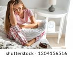lonely woman suffering from... | Shutterstock . vector #1204156516