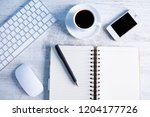 office supplies on the wooden... | Shutterstock . vector #1204177726