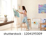 Female Artist Painting Picture...