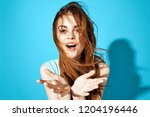 beautiful woman on blue... | Shutterstock . vector #1204196446