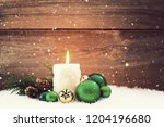 candle and green christmas... | Shutterstock . vector #1204196680