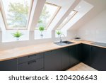 bright kitchen with slanted...   Shutterstock . vector #1204206643