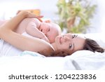 young mother plays with the... | Shutterstock . vector #1204223836