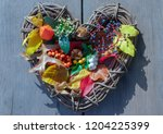 wicker heart filled with autumn ... | Shutterstock . vector #1204225399