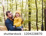 a portrait of a father holding... | Shutterstock . vector #1204228870