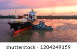 container ship in export and... | Shutterstock . vector #1204249159