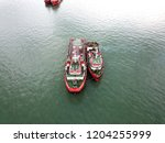 aerial view of tugboat... | Shutterstock . vector #1204255999