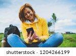 smile women holding in female... | Shutterstock . vector #1204266199