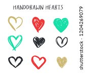 set of nine hand drawn heart.... | Shutterstock .eps vector #1204269079
