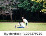 mother and daughter stretching | Shutterstock . vector #1204279210