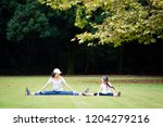 mother and daughter stretching | Shutterstock . vector #1204279216