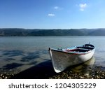 lonely boat at the lakeside.   Shutterstock . vector #1204305229