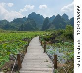 guilin yangshuo mountain range | Shutterstock . vector #1204316899