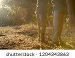 rubber boots in backlight..... | Shutterstock . vector #1204343863
