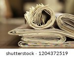 newspaper background.texture of ... | Shutterstock . vector #1204372519