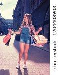 dark haired shopaholic. dark... | Shutterstock . vector #1204408903