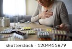 old lady feeling unwell ... | Shutterstock . vector #1204455679