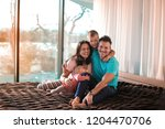 parents with two toddlers... | Shutterstock . vector #1204470706