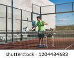 monitor teaching padel class | Shutterstock . vector #1204484683