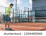 monitor teaching padel class | Shutterstock . vector #1204485040