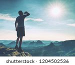 sportsman drinking water in... | Shutterstock . vector #1204502536