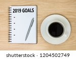 2019 goals on paper book and... | Shutterstock . vector #1204502749