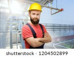 worker on a industrial fridge... | Shutterstock . vector #1204502899
