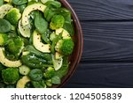 green baby spinach salad with... | Shutterstock . vector #1204505839