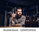 tattooed hipster male with... | Shutterstock . vector #1204514326