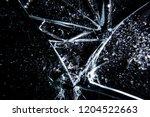 a broken glass on a dark... | Shutterstock . vector #1204522663