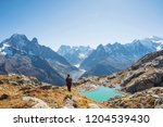 young hiker feeling free in... | Shutterstock . vector #1204539430