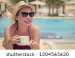 young european lady in a sunhat ... | Shutterstock . vector #1204565620
