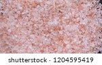 pink himalayan salt rotating.... | Shutterstock . vector #1204595419