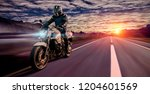 motorcycle driving on empty... | Shutterstock . vector #1204601569