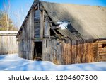 destroyed the old wooden barn... | Shutterstock . vector #1204607800